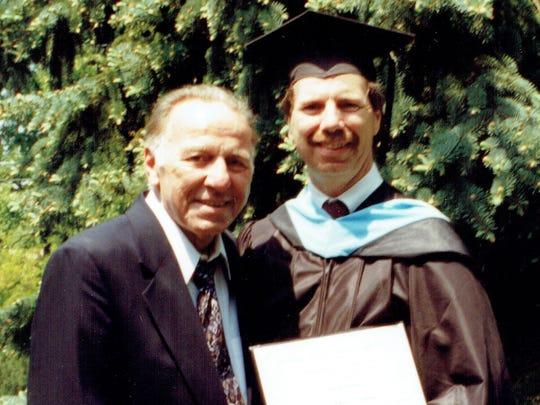 Beacon football coach Tony Truscello alongside his