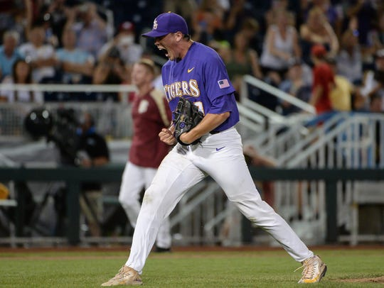 LSU Tigers pitcher Zack Hess (38) reacts after defeating
