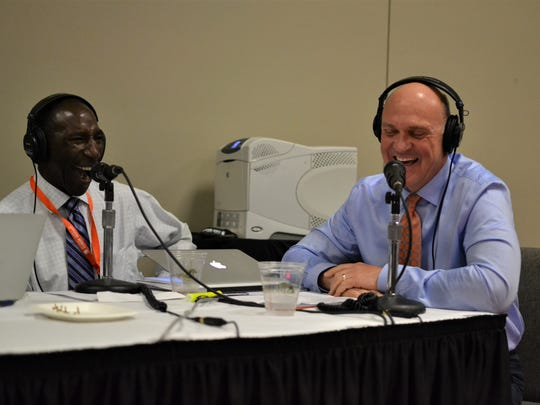 Lee Gill, Clemson University's chief diversity officer, and Clemson President Jim Clements laugh during a live taping of the Tom Joyner Morning Show on Thursday at the TD Convention Center in Greenville during Clemson University's Men of Color National Summit.