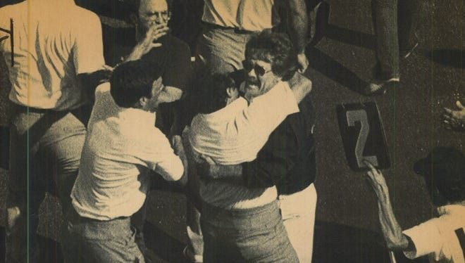 Iowa coach Hayden Fry, right, hugs Barry Alvarez after the upset of Nebraska.