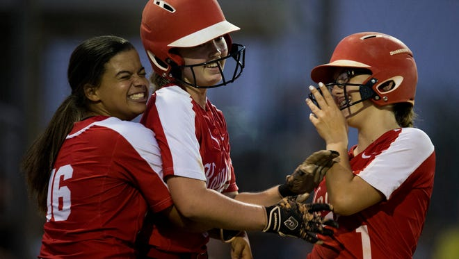 After trailing almost the entire game North Fort Myers' Sajarie Jones, from left, Mackenzie Peterson, and Marion Reed are all smiles as the game-tying run is scored against Barron Collier in the seventh inning during the Class 6A regional semifinal Tuesday, May 9, 2017. North Fort Myers would win 8-4.