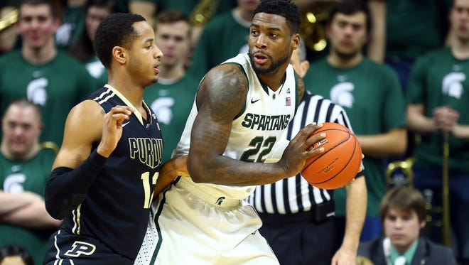 Michigan State Spartans guard/forward Branden Dawson (22) posts up against Purdue Boilermakers forward Vince Edwards (12) during the 1st half of a game at Jack Breslin Student Events Center.