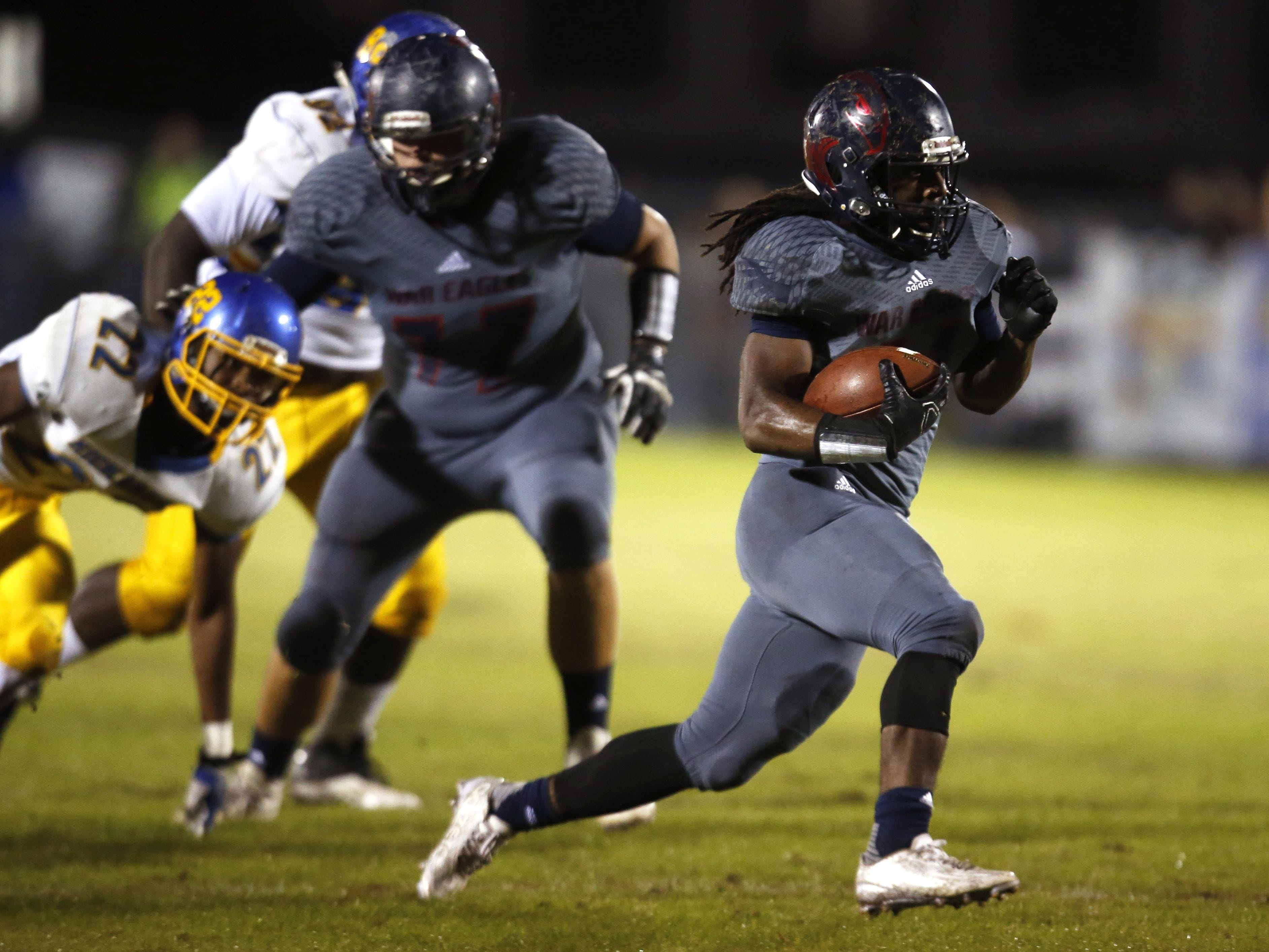 Wakulla's Demarcus Lindsey takes off for a long run down to the one-yard line against Rickards during their playoff game on Friday.
