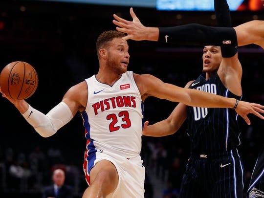 Detroit Pistons forward Blake Griffin (23) passes as Orlando Magic forward Aaron Gordon (00) defends during the first half of an NBA basketball game, Monday, Oct. 7, 2019, in Detroit. (AP Photo/Carlos Osorio)