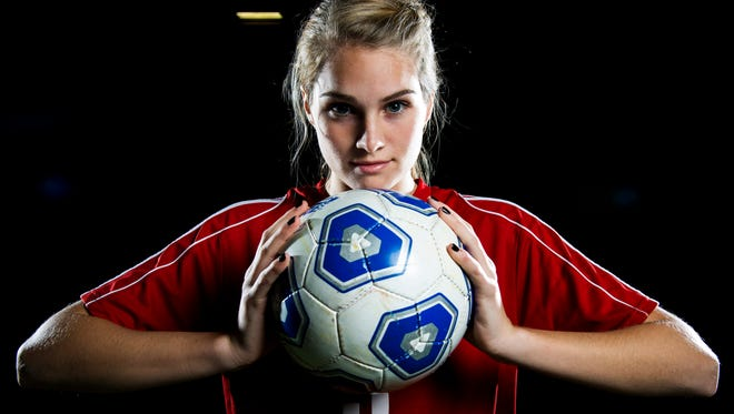 Champlain Valley's Paige DuBrul, the 2014 Free Press girls soccer player of the year, poses for a portrait at the Essex Expo Center.