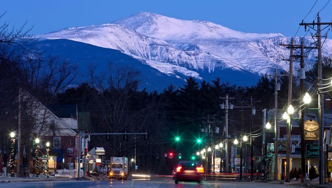 FILE  - In this March 13, 2015 file photo, Mount Washington is seen at dawn from North Conway, New Hampshire. The owners of the Mount Washington Cog Railway that climbs to the highest peak in the Northeast want to build an upscale hotel a mile from the summit, in keeping with hotels that once graced the mountain in the 1800s.