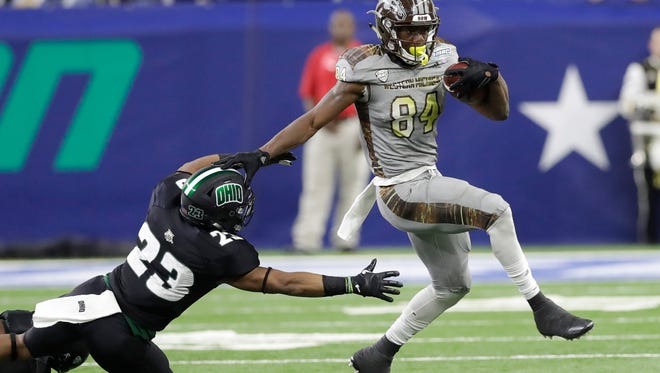 Western Michigan wide receiver Corey Davis (84) pulls away from Ohio safety Kylan Nelson during the first half of the Mid-American Conference championship Dec. 2, 2016, in Detroit.