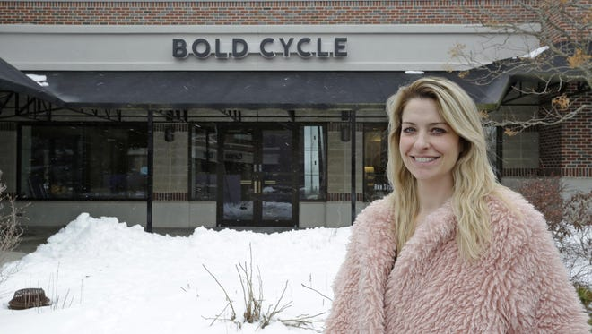 Ashley Kohler poses near the storefront for Bold Cycle, Tuesday, April 17, 2018, in Sheboygan, Wis.  The firm will open later this year.