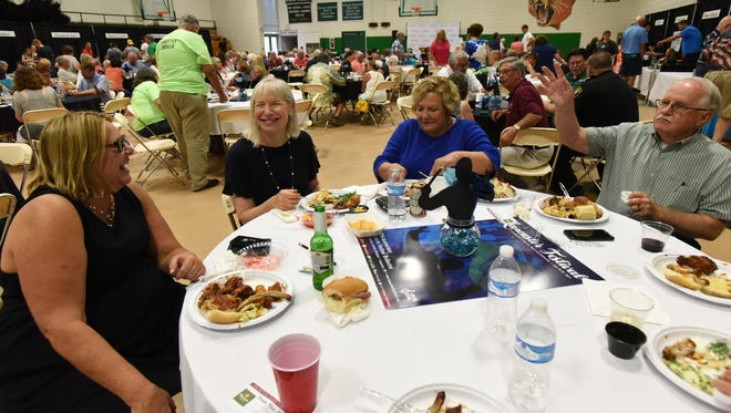 Lancaster Festival Orchestra members Diane Schick, left, and Amy Shevrin, second from left, laugh as they have dinner with SallyAnn Haase and Bill Haase Tuesday, July 19, 2017, at Ohio University Lancaster. The Schick and Shevrin have stayed with the Haases during the festival since 1995.