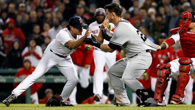 New York Yankees first baseman Tyler Austin (26) starts a scrum with Boston Red Sox relief pitcher Joe Kelly (56) during the seventh inning against the Boston Red Sox at Fenway Park.