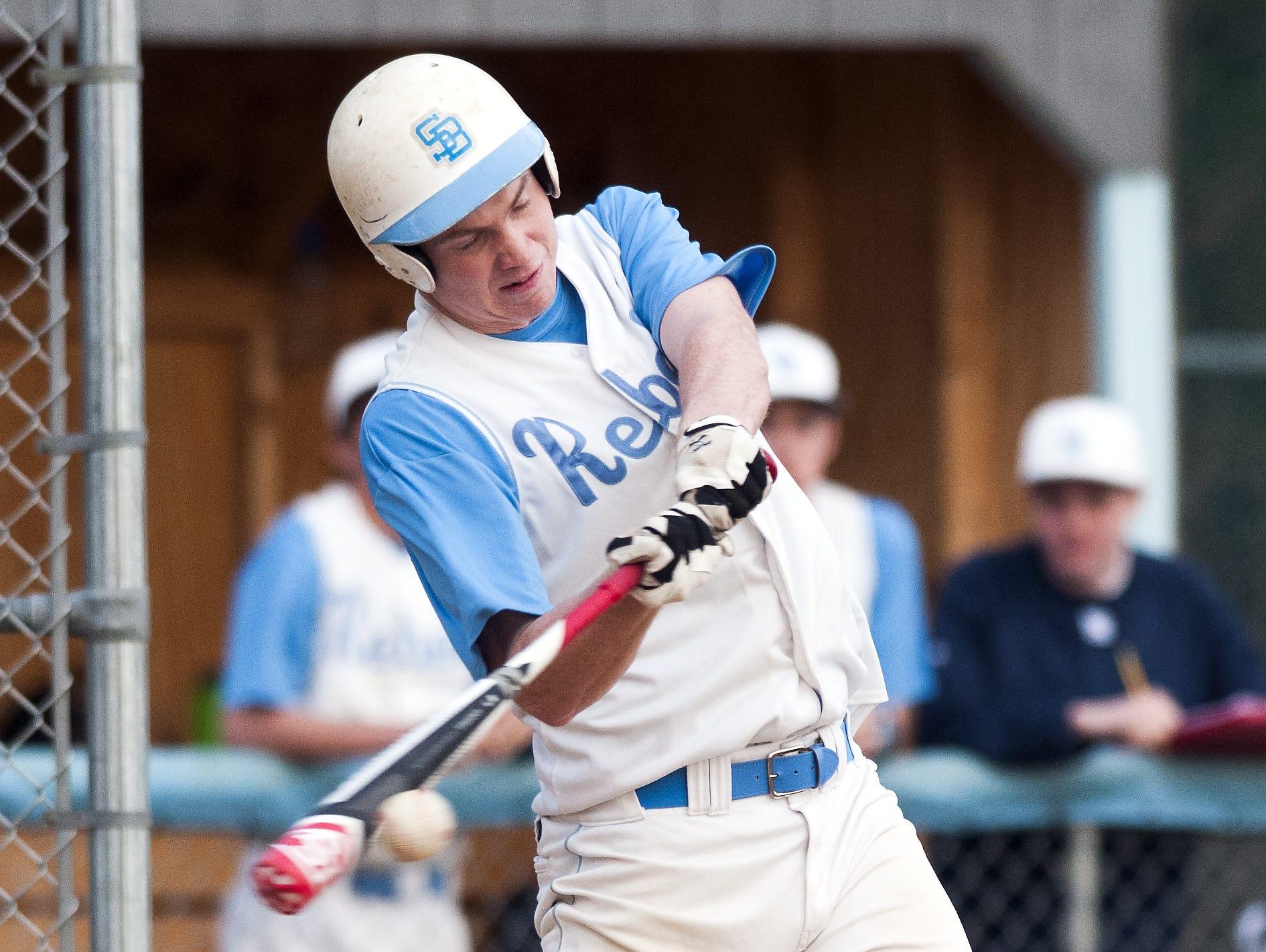 South Burlington's Connor Bradley (10) hits the ball during Thursday's baseball game against Champlain Valley.