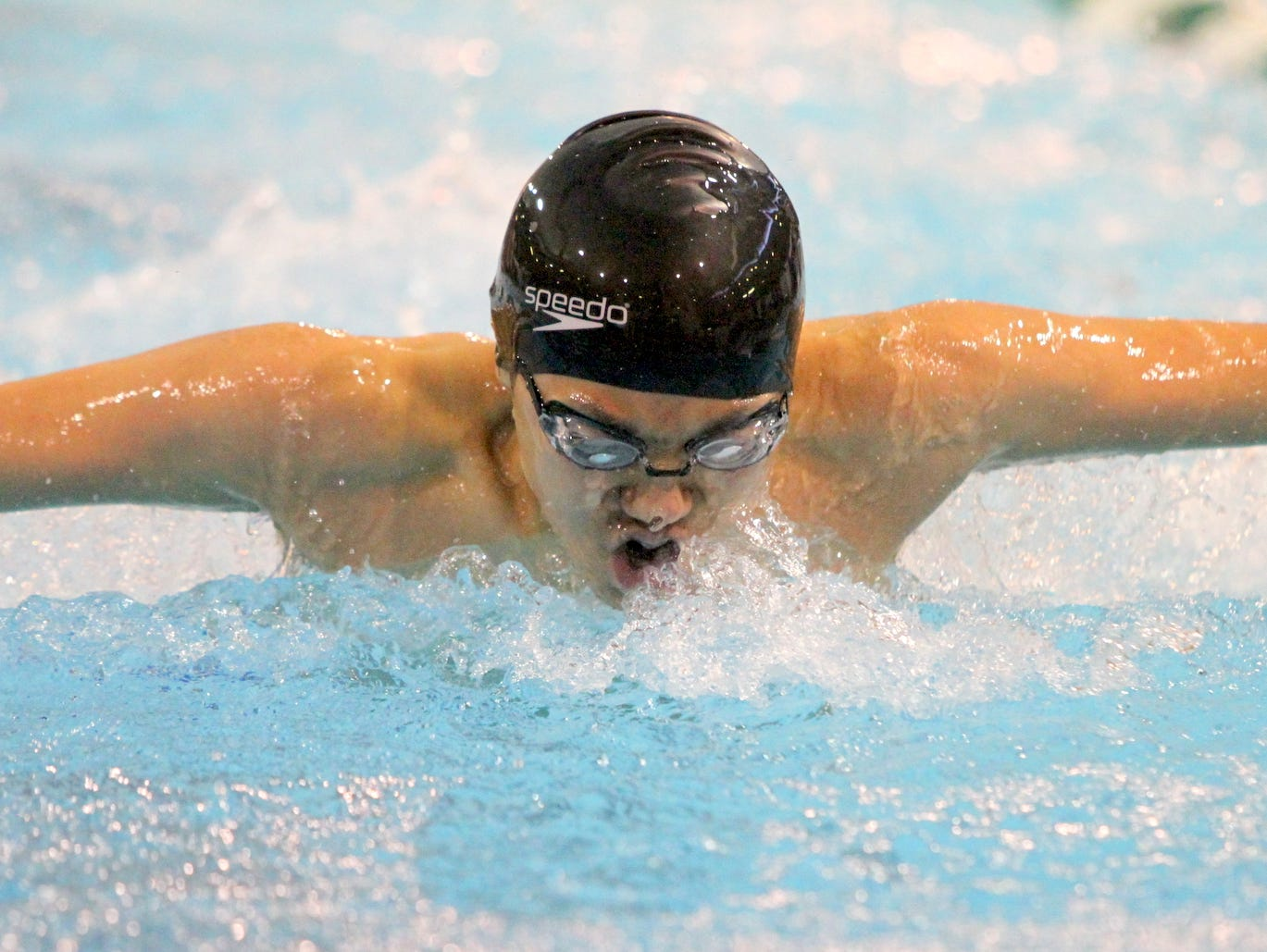 Shoonshin Li of Horseheads swims to victory in the 100-yard butterfly during the John Beecher Swimming and Diving Invitational at Ernie Davis Academy's Thomas Natatorium.