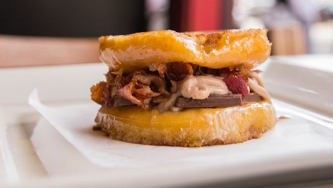 Tom+Chee will unveil its new grilled cheese doughnut, Choco Bacon Bliss, at the Newport store's grand reopening.