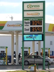 Motorists fuel up Tuesday at Express on South Oneida