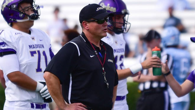 Franklin native Mike Houston has been named the Colonial Athletic Association football coach of the year following his first season at James Madison.