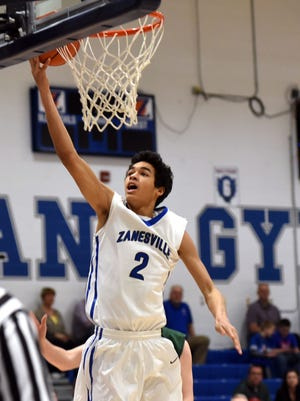 Zanesville's Cameron Brooks-Harris drives for a basket during a game last season. Brooks-Harris signed with Marshall on Thursday during a ceremony at the high school.
