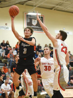 Ridgewood's Koleten Smith goes up for a shot over a Sandy Valley defender in Tuesday's 70-65 district semifinal win.