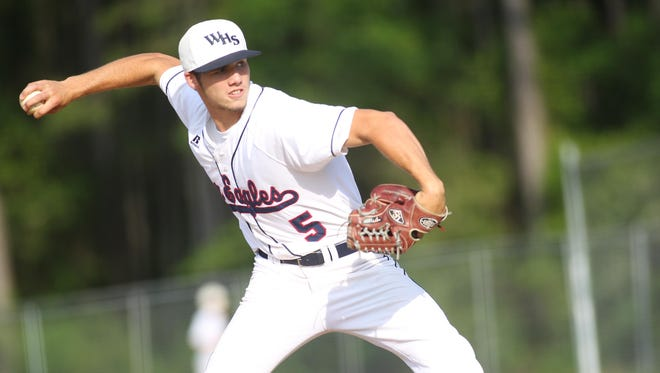 Wakulla pitcher Aaron Ginn throws a pitch in a 6-5 loss to West Florida on Wednesday.