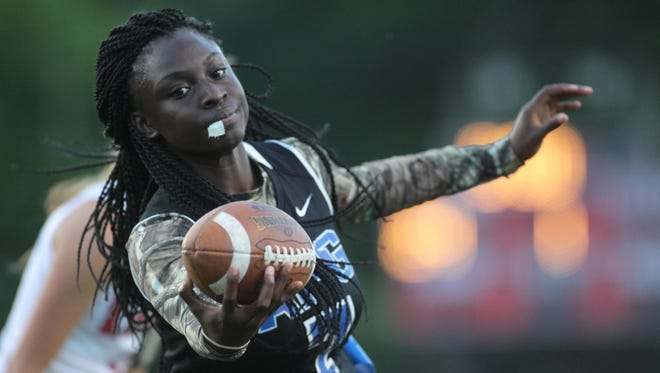 Godby's Jamecia Mitchell stretches for a touchdown in district semifinal win over Leon. Mitchell scored two touchdowns in a 19-13 win over Chiles for the district title.