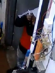 The knife in the suspect's hand can be seen in this