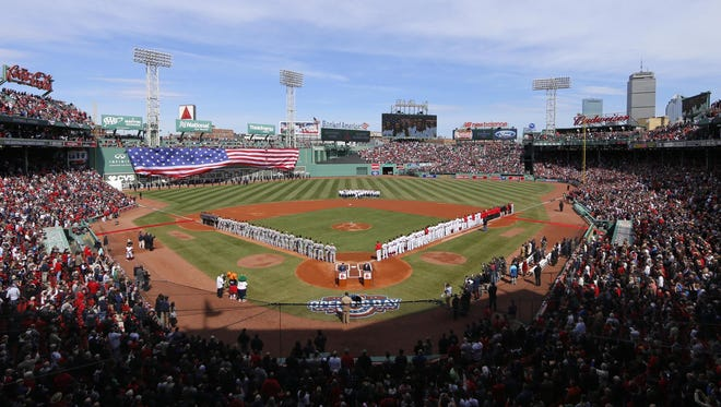 The Pittsburgh Pirates and the Boston Red Sox line up during the national anthem before the game at Fenway Park on April 3.