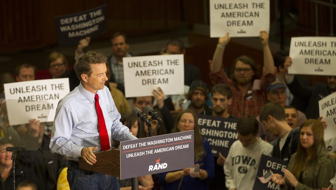 """U.S. Sen. Paul Rand speaks in Iowa City on April 10 during his first visit to Iowa as an official presidential candidate. He came on stage to """"Baba O'Riley"""" by The Who."""