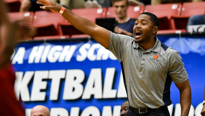 Florida Prep basketball head coach Julius Reid directs his team during Tuesday's Class 2A basketball semifinal.