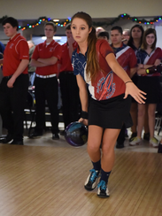 Emily Dietz throws a practice ball prior to a match