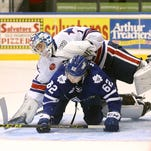 Marliers center William Nylander upends Amerks goalie Andrey Makarov during Wednesday's game, a 1-0 Toronto overtime victory.