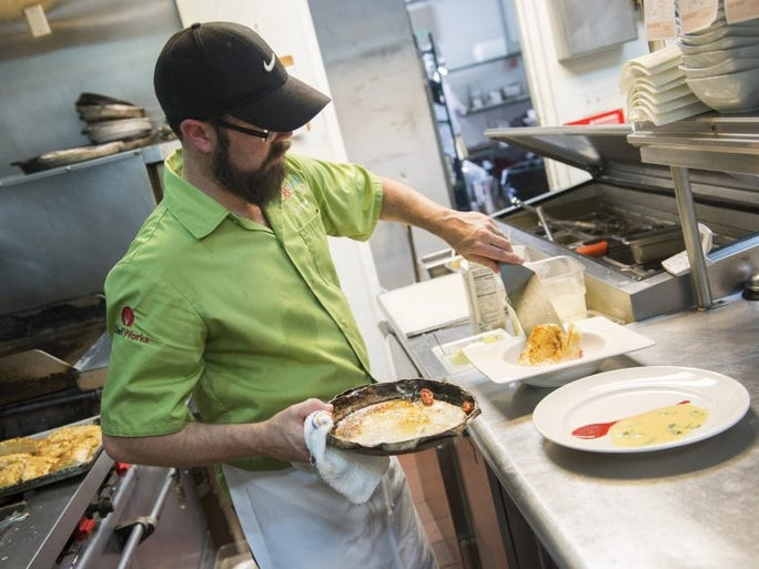 Chef Eric Grutka, owner of Ian's Tropical Grill, plates a miso roasted halibut dinner Friday, April 15 at Ian's Tropical Grill in Stuart.