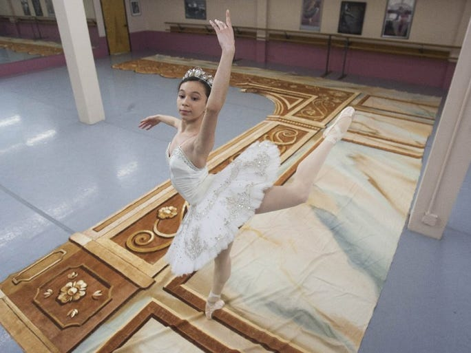 RICHARD QUINN/SPECIAL TO THE STAR Jazmine Quezada strikes a pose on a hand-painted piece of scenery that will form part of the proscenium for the Ventura County Ballet Company's production of 'Don Quixote.' Quezada is dancing the role of Cupid.