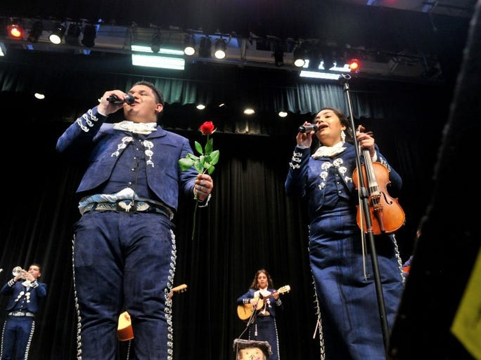 JOSEPH A. GARCIA/THE STAR Mariachi Cihualteco's Isaac Hernandez (left), and Maricela Torres, both from Oxnard, perform 'Mi Tesoro' during Mariachi de Mi Tierra's second annual Mariachi Extravaganza. Thursday's free concert was at the Oceanview Pavilion Performing Arts Theatre by the Beach in Port Hueneme.