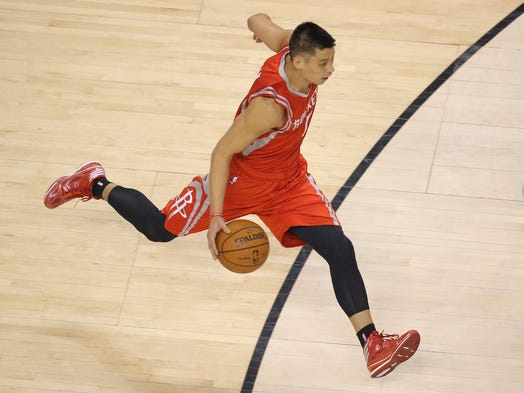 Houston Rockets guard Jeremy Lin charges ahead with the ball against the Toronto Raptors at Air Canada Centre.