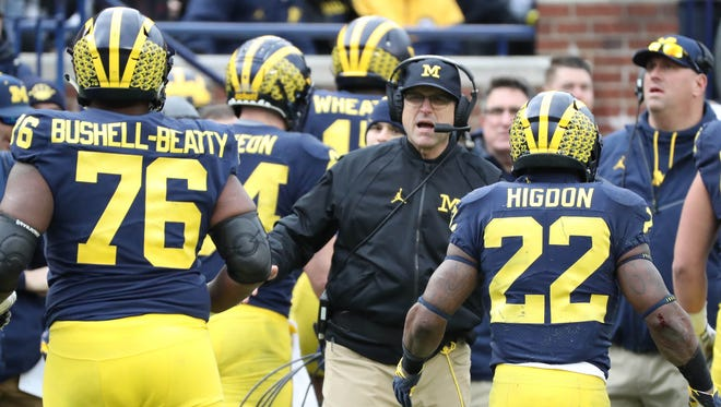 Michigan head coach Jim Harbaugh on the sideline during the third quarter against Ohio State on Saturday, Nov. 25, 2017 at Michigan Stadium.