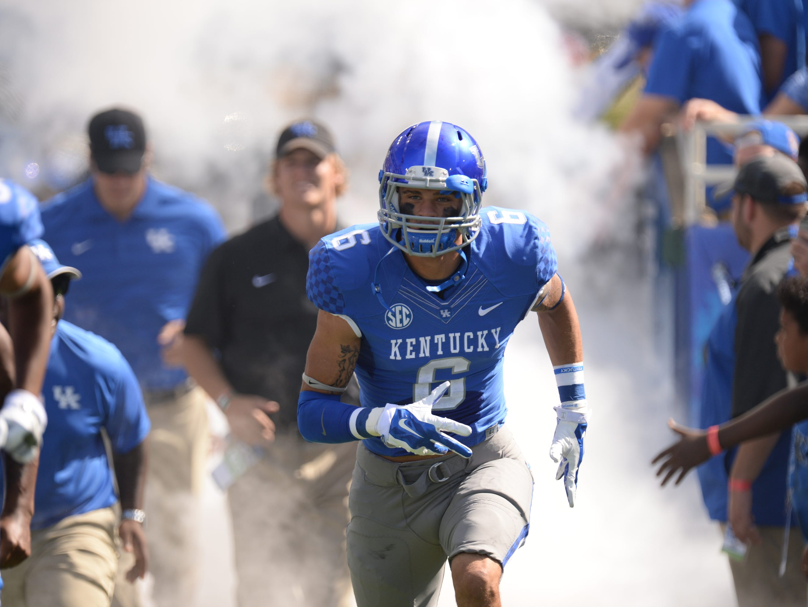 Freshman WR Blake Bone runs out of the tunnel before the University of Kentucky Football game against the Vanderbilt Commodores in Lexington, KY. Saturday, September 27, 2014.