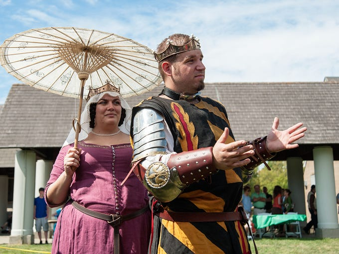 Members of the Society for Creative Anachronism Jaime Haley, right, and his wife Erin Fortney portray the Baron Jaime and Baroness Eleanor as they address champions about to fight in a championship staged at the Louisville Irish Fest held on the Bellarmine University  campus. September 28, 2014