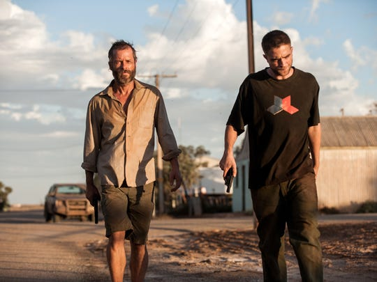 "Guy Pearce and Robert Pattinson in a scene from ""The Rover."""