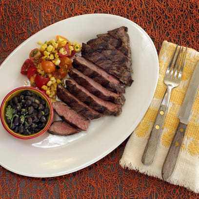 Grilled skirt steak, beer-braised black beans and blistered corn and tomato salsa.