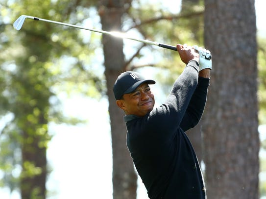 Tiger Woods hits his tee shot on the 4th hole during