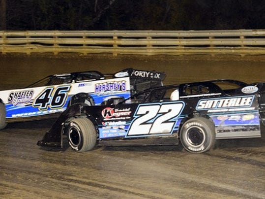 Marvin Winters (46) maintains his lead over Gregg Satterlee (22) during the Ernie D's Fall Bash Late Model race Saturday night at Hagerstown Speedway. Winters, of McConnellsburg, went on to win his 100th career victory.