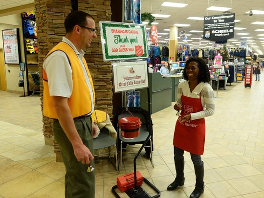 Great Falls Lions Club members Keith Schnider and Raymonde Page volunteer as Salvation Army bell ringers at Scheels.
