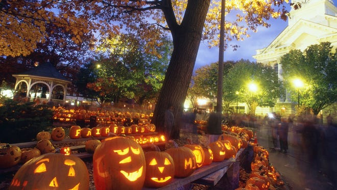 Keene, N.J., does the pumpkin proud at its annual festival with pumpkin bowling, a parade and the unforgettable sight of thousands of glowing jack-o-lanterns assembled in towers.