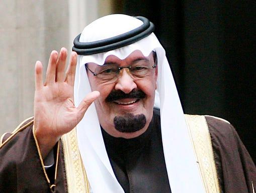 Saudi King Abdullah waves to reporters in October 2007