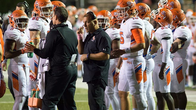 Phil Longo (center) was in charge of a prolific offense while at Sam Houston State.