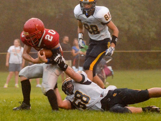 -MAN s Luth vs Ozaukee FB 01.jpg_20140822.jpg