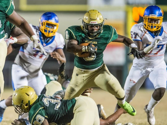 Acadiana High's Ziggy Francis (6) jumps over his teammate