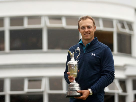 Jordan Spieth of the United States holds the trophy