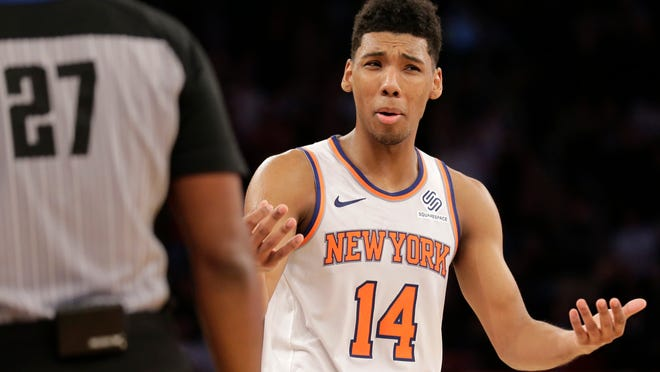New York Knicks' Allonzo Trier reacts to a foul call in the last second of double overtime of an NBA basketball game, Monday, Nov. 5, 2018, in New York. The Bulls defeated the Knicks in double overtime 116-115. (AP Photo/Seth Wenig)