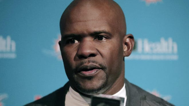 Miami Dolphins head coach Brian Flores speaks to the media following an NFL football game against the New England Patriots.