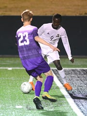 Abilene High's Enock Gasore tries to dribble the ball around a Keller Timber Creek player during the Eagles' shootout win over the Falcons on Friday at Shotwell Stadium.